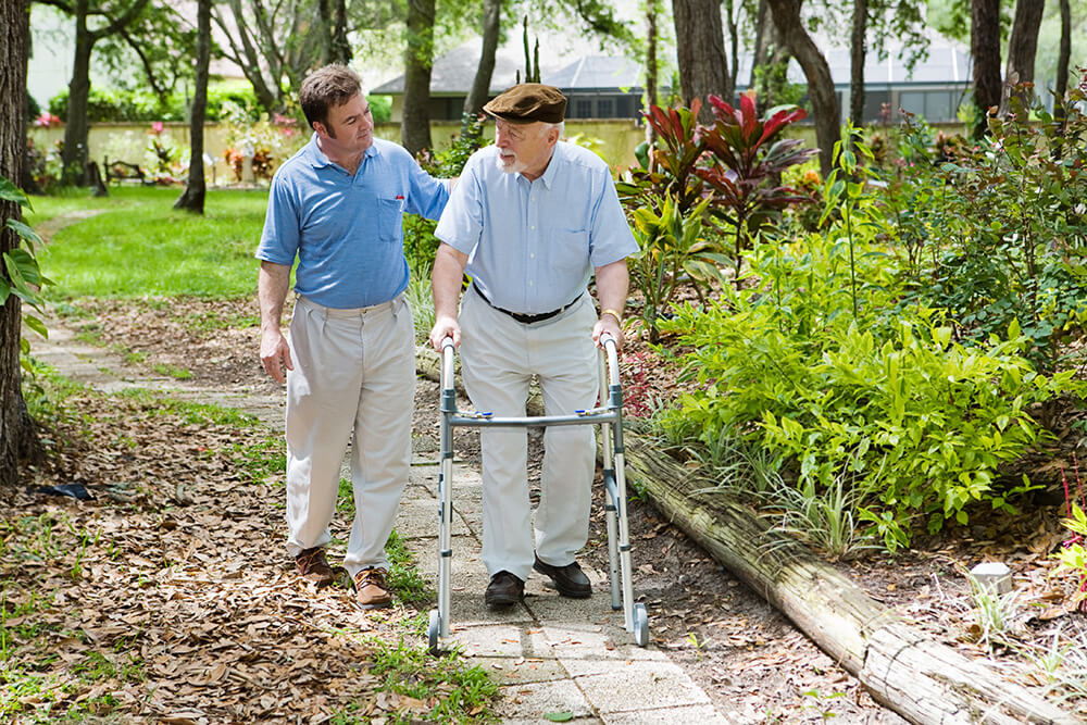 Lancaster, PA Caregiver and Senior Dementia Patient Walking in Garden