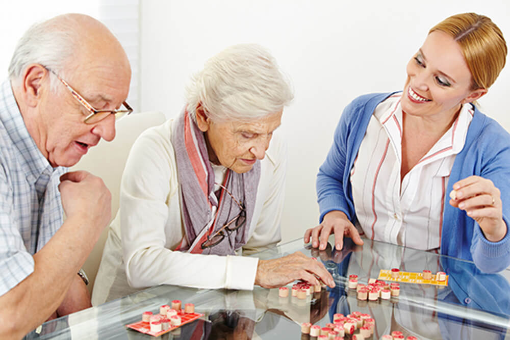 York, PA Dementia Patients Doing Puzzle Activity with Caregiver