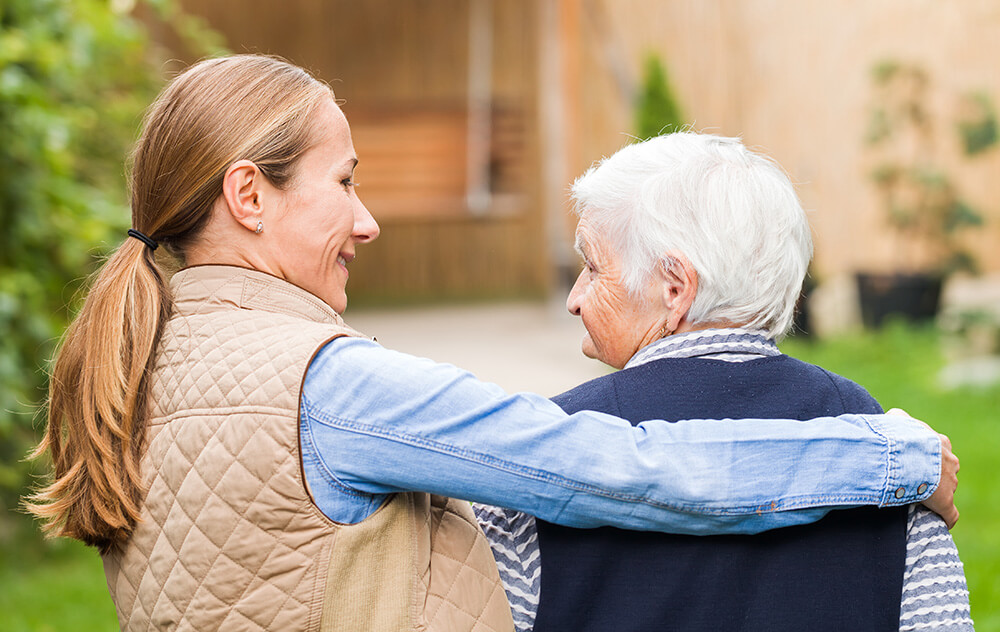 Caregiver and dementia patient walking