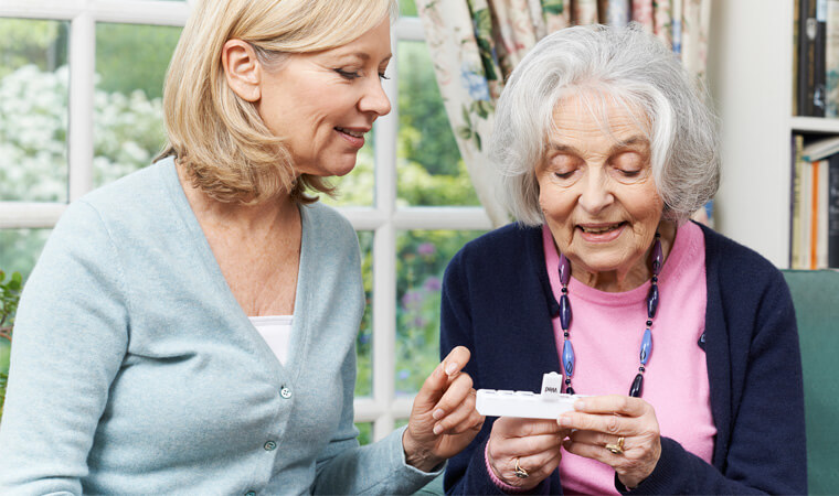 Caregiver helping patient with medications