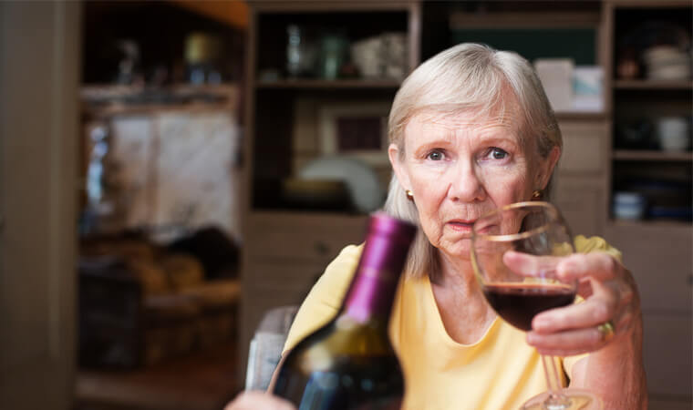 Elderly woman struggling with alcoholism